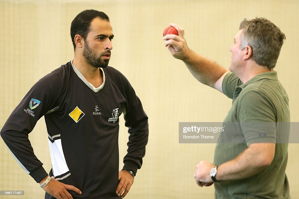 Former Australia cricket player Stuart MacGill (R) chats to Victorian player Fawad Ahmed during a meeting at the Sydney Cricket Ground Indoor Nets on March 28, 2013 in Sydney, Australia.
