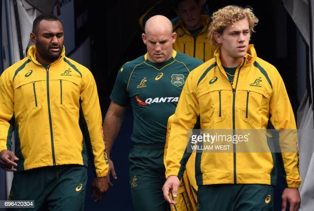 Former Australia rugby captain Stephen Moore walks out with teammates Tevita Kuridrani and Ned Hanigan for the team's Captain's Run in Sydney on 16...