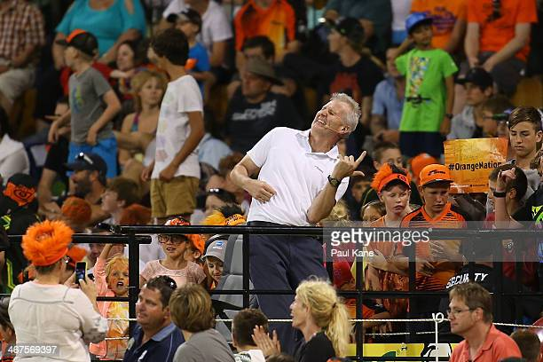 Former Australian basketballer Andrew Gaze plays an air guitar during the Big Bash League Final match between the Perth Scorchers and the Hobart...