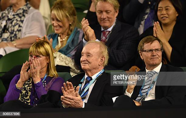 Former Australian champion Rod Laver applauds as Spain's Carla Suarez Navarro plays during her women's singles match against Australia's Daria...