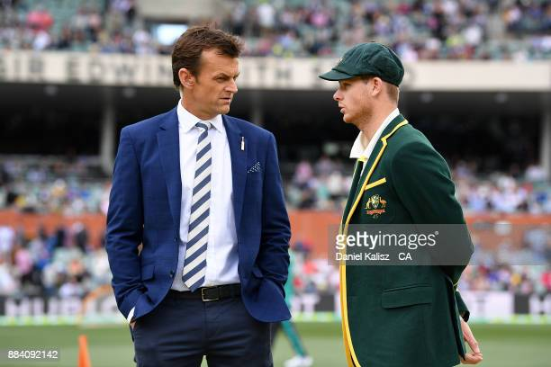 Former Australian Cricketer Adam Gilchrist chats with Steven Smith of Australia during day one of the Second Test match during the 2017/18 Ashes...