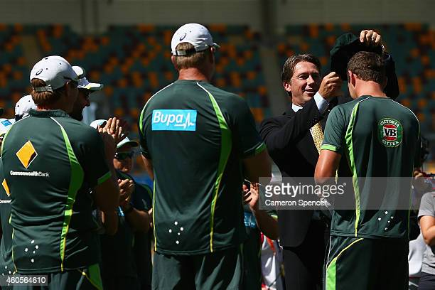Former Australian cricketer Glenn McGrath presents Josh Hazlewood of his Australia with his Baggy Green test cap on his debut during day one of the...