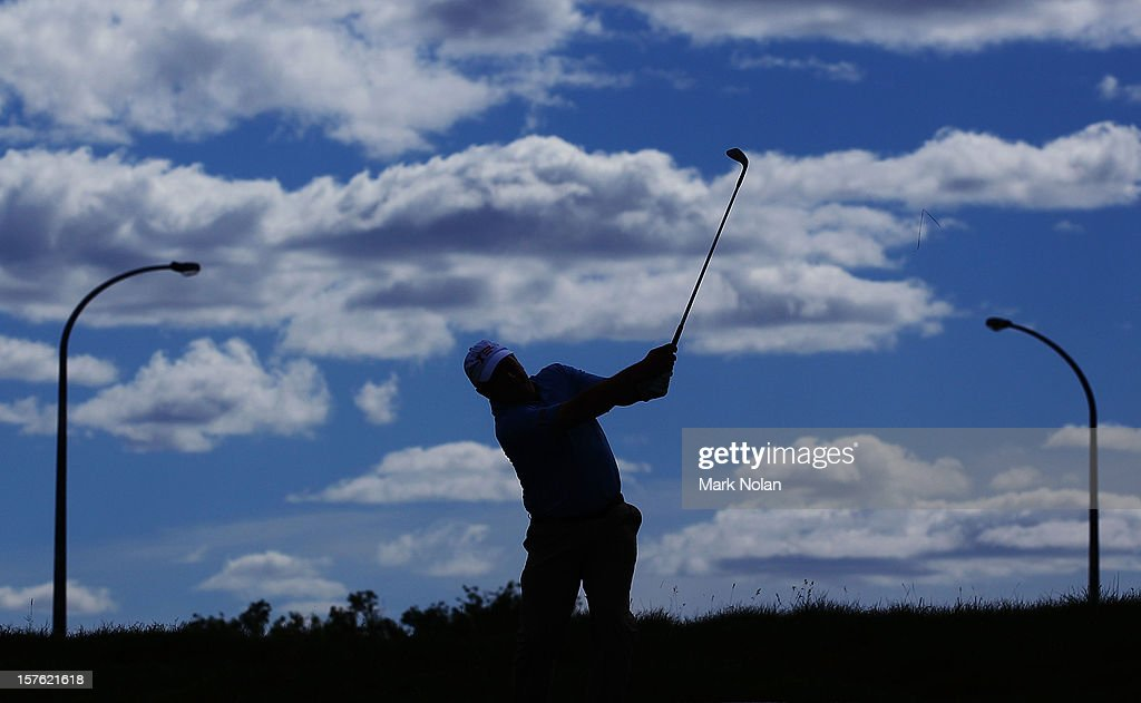 Former Australian cricketer Ian Healy hits out of the rough during the Pro-Am ahead of the 2012 Australian Open, beginning tomorrow, at The Lakes Golf Club on December 5, 2012 in Sydney, Australia.