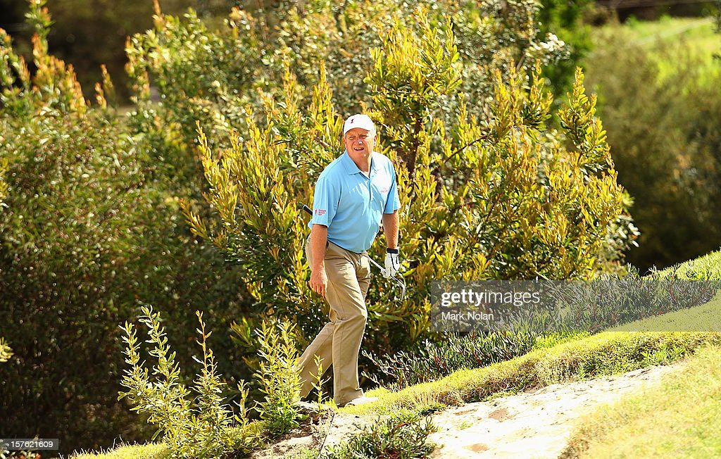 Former Australian cricketer Ian Healy searches for his ball during the Pro-Am ahead of the 2012 Australian Open, beginning tomorrow, at The Lakes Golf Club on December 5, 2012 in Sydney, Australia.