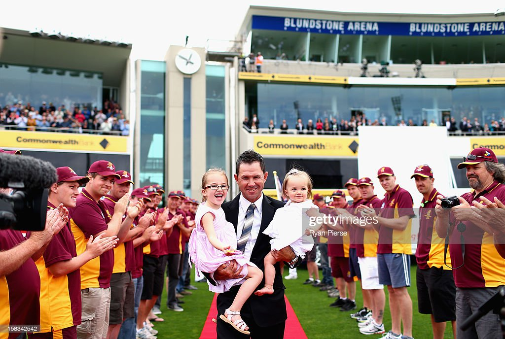 Former Australian cricketer Ricky Ponting is presented to the crowd after a farewell lap with his daughters Emmy and Matisse during day one of the First Test match between Australia and Sri Lanka at Blundstone Arena on December 14, 2012 in Hobart, Australia.