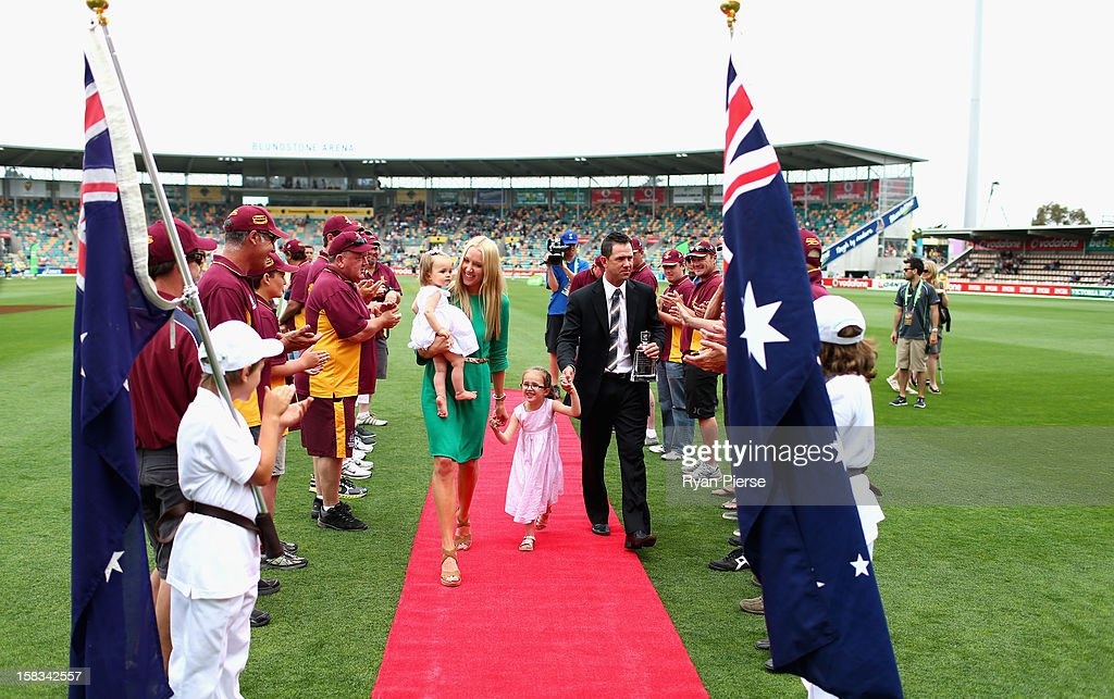 Former Australian cricketer Ricky Ponting is presented to the crowd after a farewell lap with his wife Rianna and daughters Emmy and Matisse during day one of the First Test match between Australia and Sri Lanka at Blundstone Arena on December 14, 2012 in Hobart, Australia.