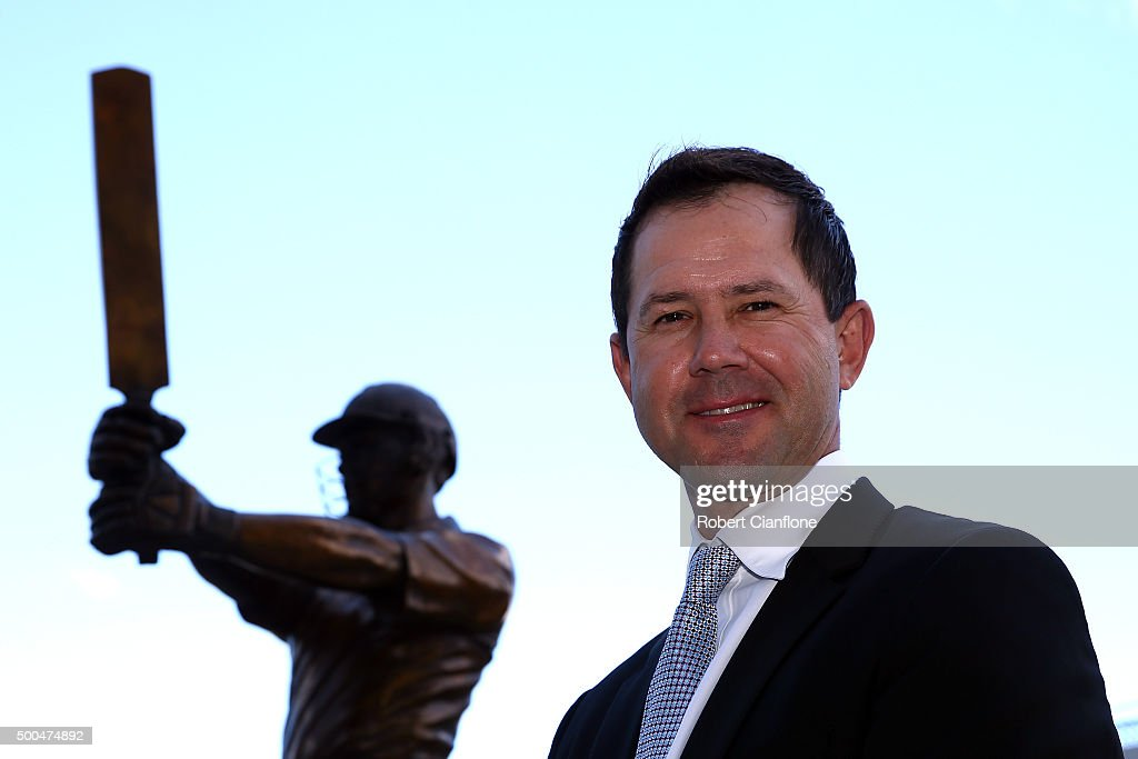 Former Australian cricketer Ricky Ponting poses with the the statue made in his honour, after it was unveiled at Blundstone Arena on December 9, 2015 in Hobart, Australia.