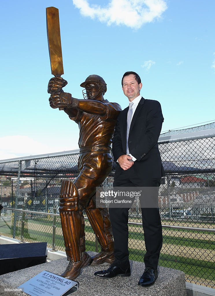 Former Australian cricketer <a gi-track='captionPersonalityLinkClicked' href=/galleries/search?phrase=Ricky+Ponting&family=editorial&specificpeople=176564 ng-click='$event.stopPropagation()'>Ricky Ponting</a> poses with the the statue made in his honour, after it was unveiled at Blundstone Arena on December 9, 2015 in Hobart, Australia.