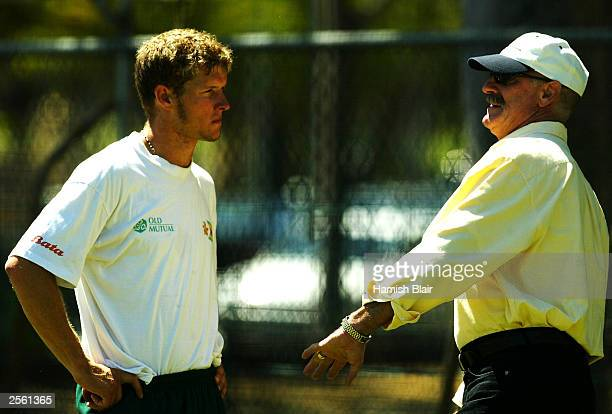 Former Australian fast bowlng great Dennis Lillee speaks to Andy Blignaut of Zimbabwe during day three of the tour match between Western Australia...