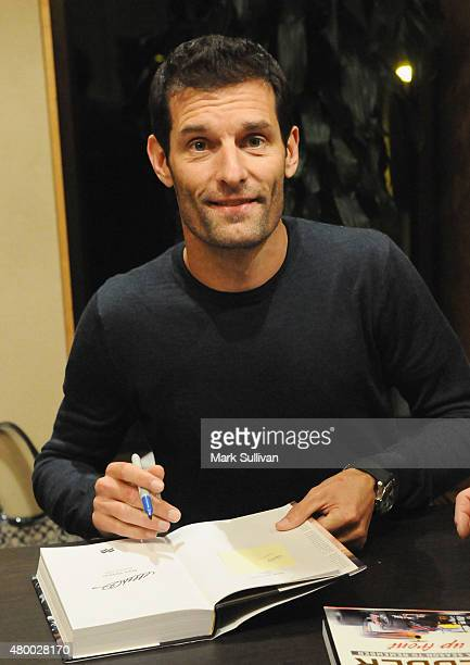 Former Australian Formula One driver Mark Webber signs his autobiography 'Aussie Grit' at Sofitel Hotel on July 9 2015 in Sydney Australia Webber who...