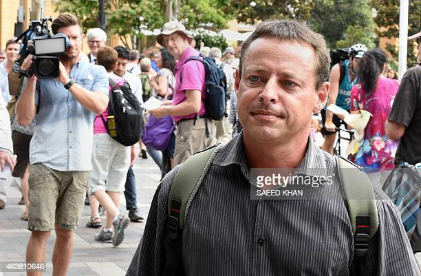 Former Australian Guantanamo Bay inmate David Hicks leaves following his talks with the media at Circular Quay in Sydney on February 19 2015 Hicks on...