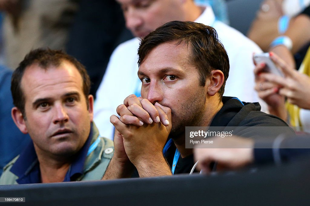 Former Australian Olympic Swimmer <a gi-track='captionPersonalityLinkClicked' href=/galleries/search?phrase=Ian+Thorpe&family=editorial&specificpeople=162699 ng-click='$event.stopPropagation()'>Ian Thorpe</a> watches on during day one of the 2013 Australian Open at Melbourne Park on January 14, 2013 in Melbourne, Australia.