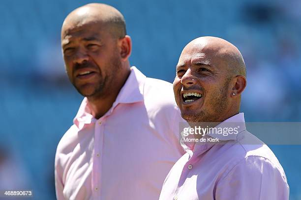 Former Australian player Andrew Symonds and former South African player Herschelle Gibbs look on during day one of the First Test match between South...