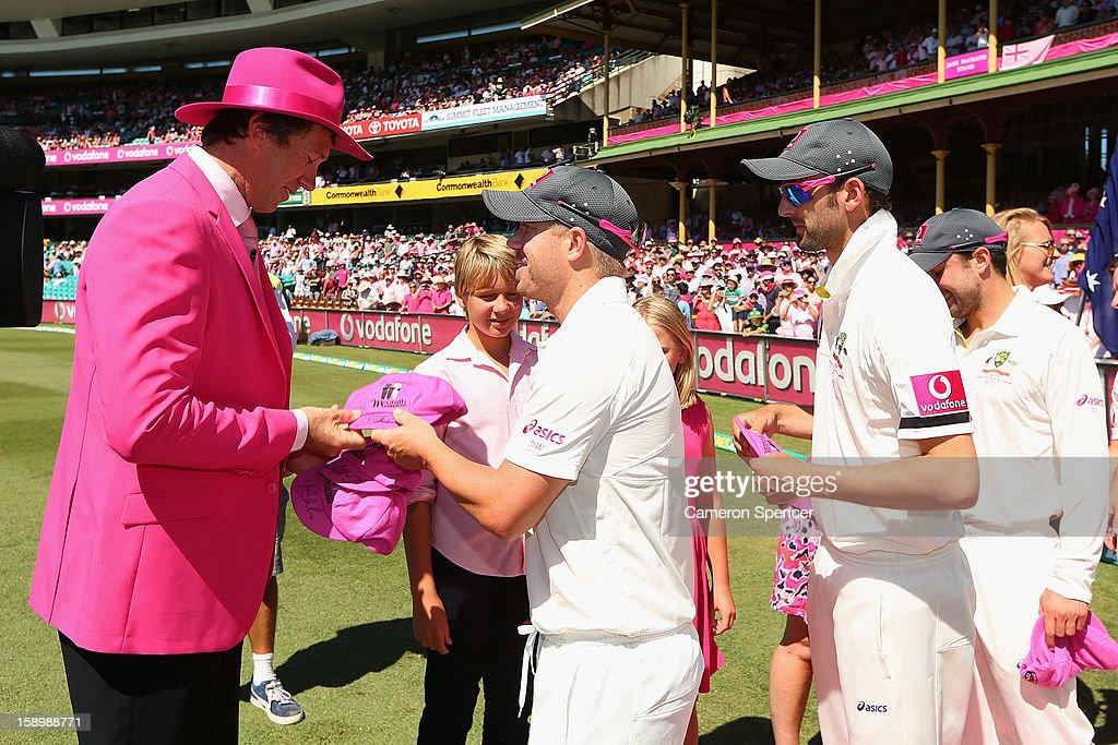 Former Australian player Glenn McGrath presents pink caps to David Warner of Australia and team mates on Jane McGrath Pink Day during day three of the Third Test match between Australia and Sri Lanka at Sydney Cricket Ground on January 5, 2013 in Sydney, Australia.
