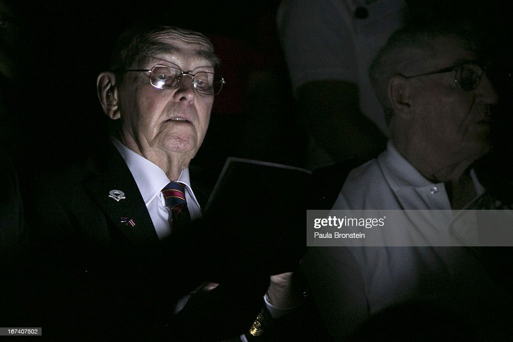 Former Australian POW Barton Richardson, 93, tries to read in the dark during the sunrise memorial service in remembrance of all those who lost their lives April 25, 2013 in Hellfire Pass, Thailand. Hellfire Pass is a small section of the Burma-Thailand railway which was built by POW's and Asian Laborers under horrific conditions during the Second World War (WWII). Heavy loss of life was suffered during construction due to disease, starvation and exhaustion.