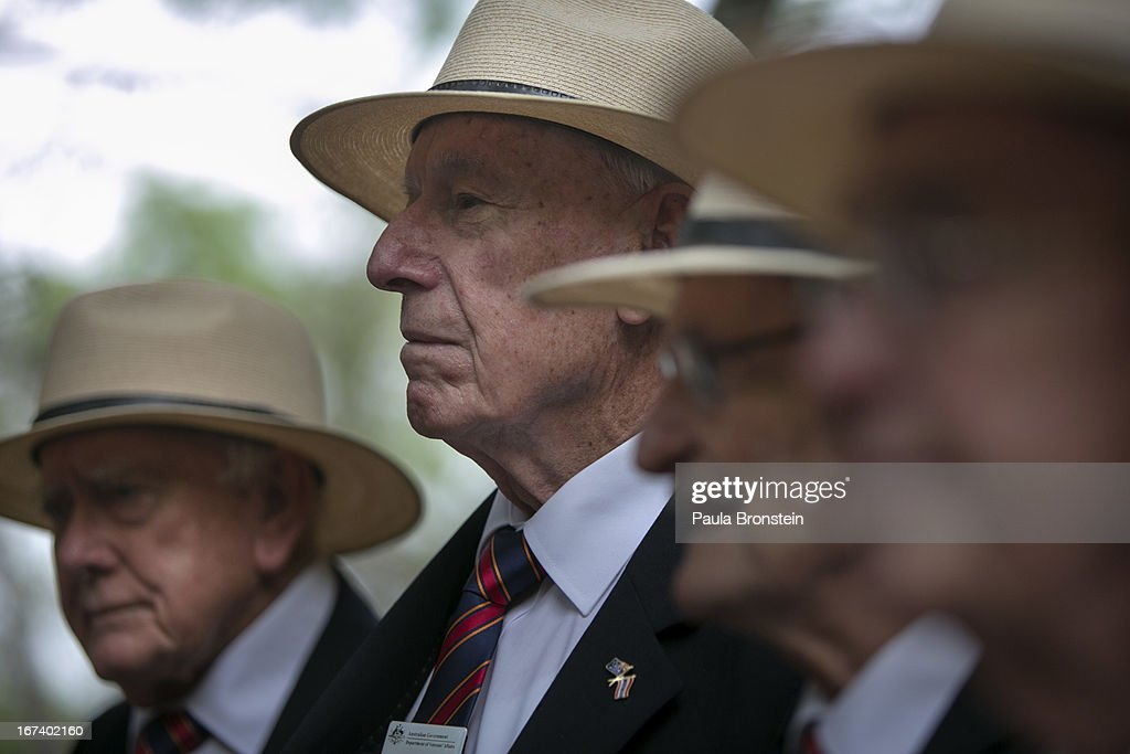 Former Australian POW Jack Thomas, 92, stands for a group portrait after the sunrise memorial service in remembrance of all those who lost their lives April 25, 2013 in Hellfire Pass, Thailand. Hellfire Pass is a small section of the Burma-Thailand railway which was built by POW's and Asian Laborers under horrific conditions during the Second World War (WWII). Heavy loss of life was suffered during construction due to disease, starvation and exhaustion.