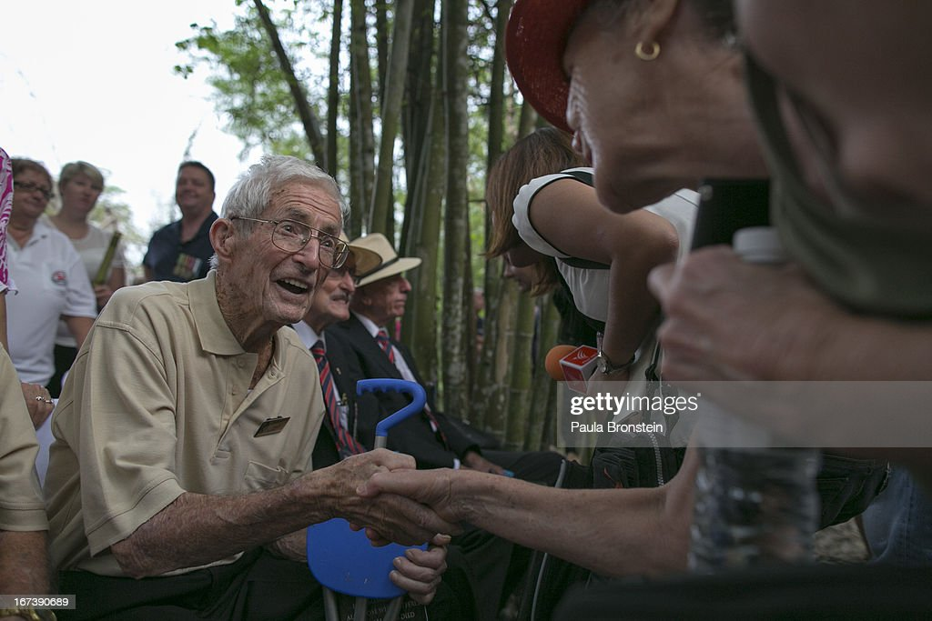 Former Australian POW Walter Holding, 93, greets people after the sunrise memorial service in remembrance of all those who lost their lives April 25, 2013 in Hellfire Pass, Thailand. Hellfire Pass is a small section of the Burma-Thailand railway which was built by POW's and Asian Laborers under horrific conditions during the Second World War (WWII). Heavy loss of life was suffered during construction due to disease, starvation and exhaustion.