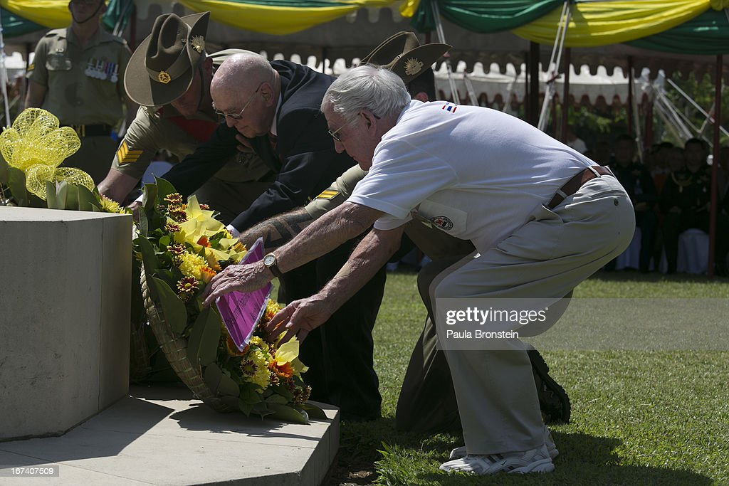 Former Australian POW's Barton Richardson, 93,(L) and Neil MacPherson (R) lay a wreath on behalf of the POW's during the Wreath Laying Ceremony at the War Cemetery in remembrance of all those who lost their lives, on April 25, 2013 in Kanchanaburi, Thailand. Hellfire Pass is a small section of the Burma-Thailand railway which was built by POW's and Asian Laborers under horrific conditions during the Second World War (WWII). Heavy loss of life was suffered during construction due to disease, starvation and exhaustion.