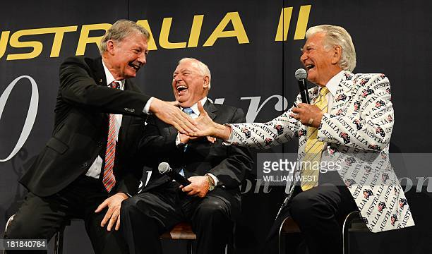 Former Australian prime minister Bob Hawke shares a joke with Australia II skipper John Bertrand and yacht owner Alan Bond at a luncheon to celebrate...