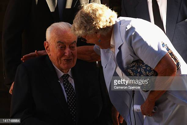 Former Australian Prime Minister Gough Whitlam is embraced during the memorial service for his wife Margaret Whitlam at St James Anglican Church on...