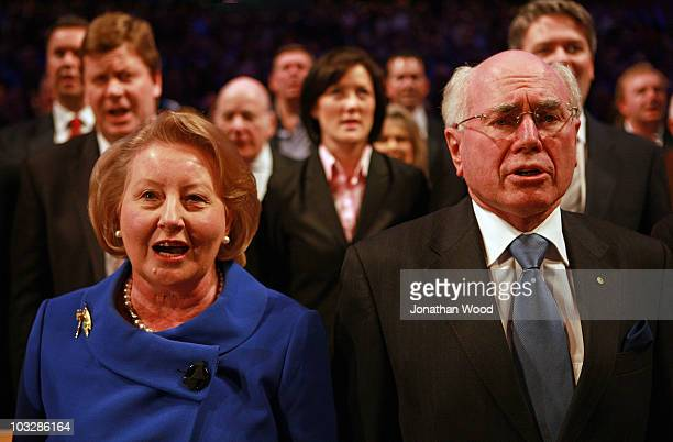 Former Australian Prime Minister John Howard and wife Janette Howard sing the national anthem during the 2010 Coalition Campaign Launch at the...
