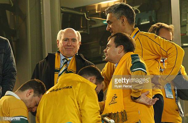 Former Australian Prime Minister John Howard looks on during the IRB 2011 Rugby World Cup Pool C match between Australia and Ireland at Eden Park on...
