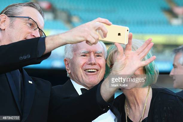 Former Australian Prime Minister John Howard poses for a selfie with a guest during the 10th Anniversary of 2006 FIFA World Cup Qualification Match...