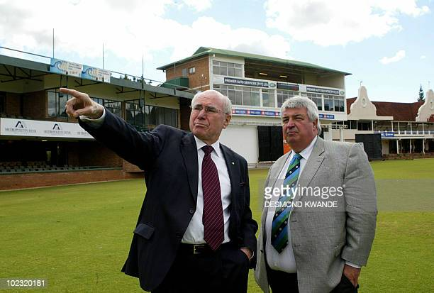 Former Australian Prime Minister John Howard speaks with cricket Australia's chairman Jack Clark at the Harare Sports Club in Zimbabwe on June 23...