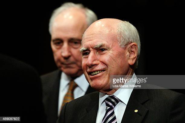 Former Australian Prime Ministers John Howard and Paul Keating greet eachother prior to German Chancellor Angela Merkel taking to the stage for the...