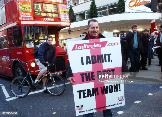 Former Australian rugby star David Campese walks down Oxford Street central London wearing a sandwich board praising England's World Cup win Campese...
