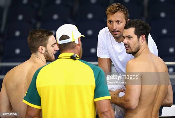 Former Australian swimmer Ian Thorpe speaks to Tommaso D'Orsogna coach Chris Mooney and Christian Sprenger of Australia during an Australian Swim...