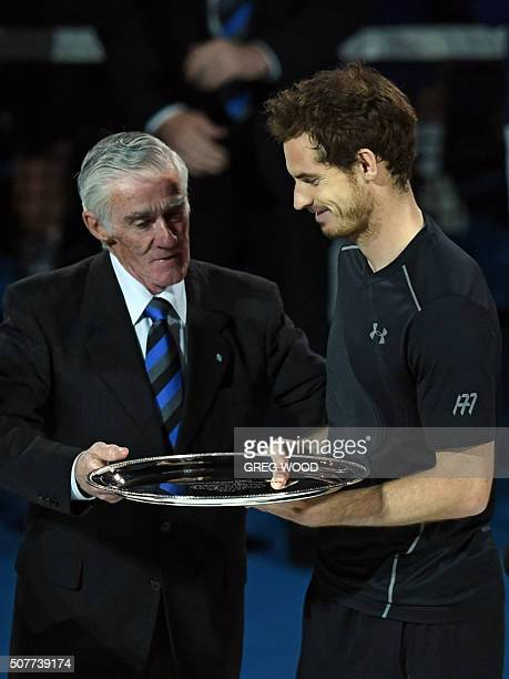Former Australian tennis champion Ken Rosewall speaks to runnerup Andy Murray of Britain as he holds up his award at the awards ceremony following...