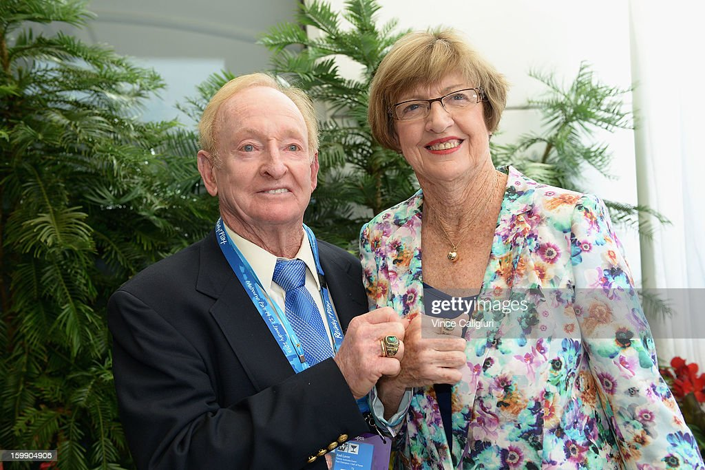 Former Australian tennis players Rod Laver and Margaret Court show their Tennis Australia legends rings during day ten of the 2013 Australian Open at Melbourne Park on January 23, 2013 in Melbourne, Australia.
