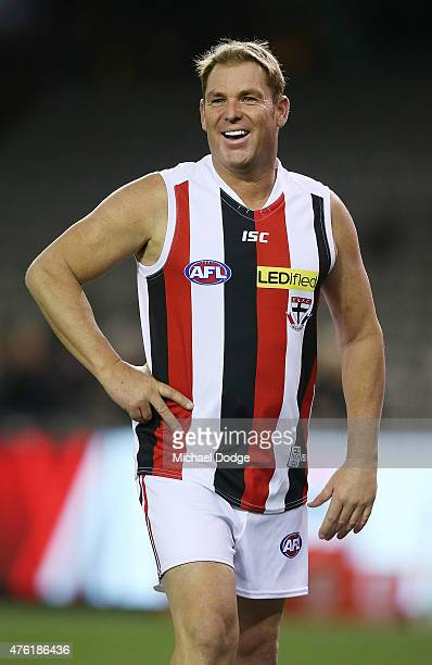 Former Australian Test cricketer and Saints fan Shane Warne reacts when playing a Saints corporate game before the round 10 AFL match between the St...