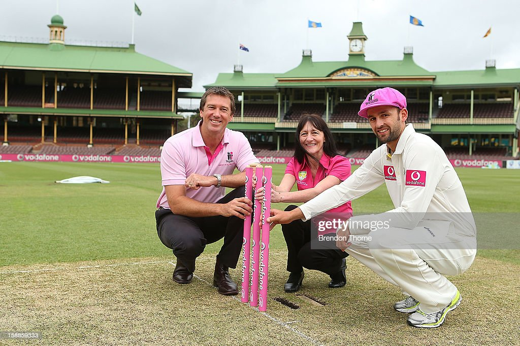 Former Australian Test cricketer, Glenn McGrath, McGrath Breast Care nurse, Karen Miles and Nathan Lyon of Australia pose as part of the build up to the Vodafone Pink Test at the Sydney Cricket Ground on January 2, 2013 in Sydney, Australia.