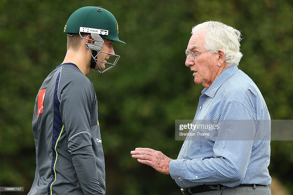 Former Australian Test crickter Alan Davidson speaks with Michael Clarke of Australia during an Australian nets session at Sydney Cricket Ground on January 2, 2013 in Sydney, Australia.