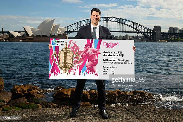 Former Australian Wallabies captain John Eales poses with a giant Rugby World Cup ticket during the 2015 Rugby World Cup Ticket Launch at Lady...