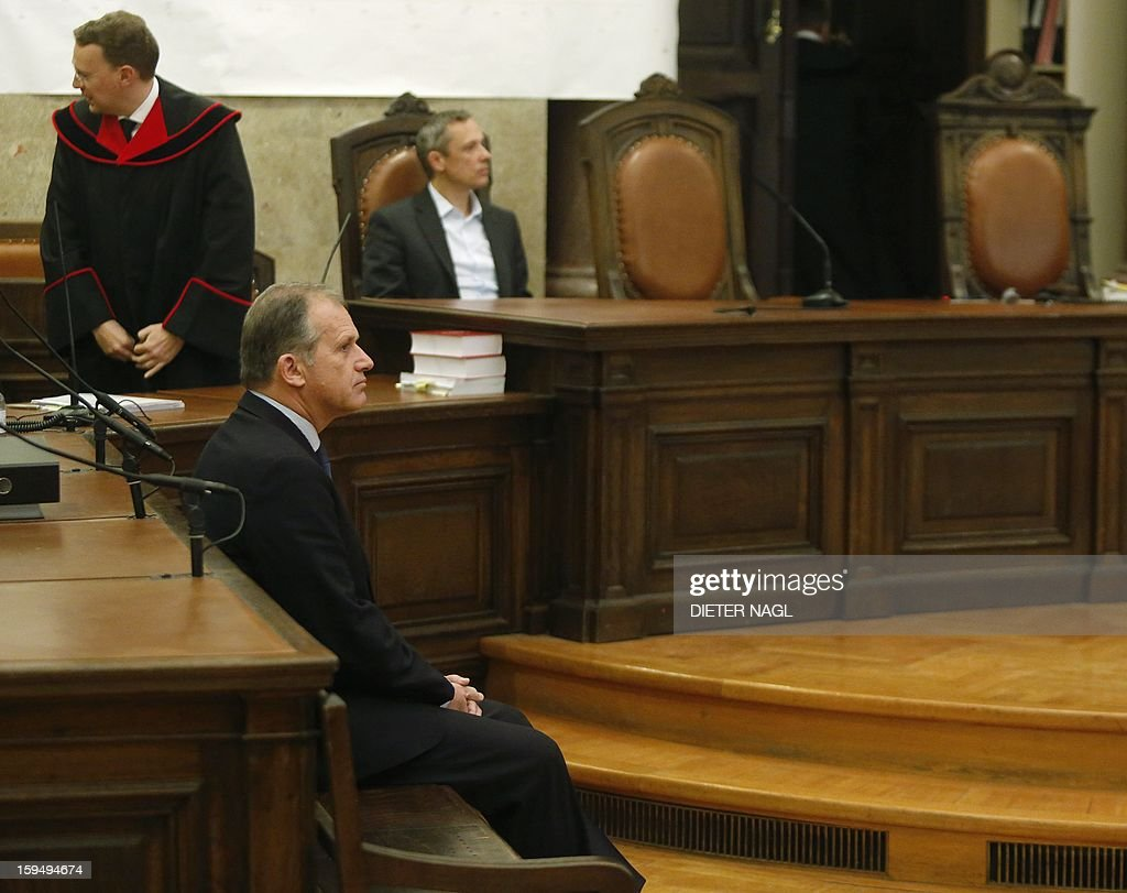 Former Austrian Interior Minister and Austrian former member of the European Parliament Ernst Strasser sits at the court room short before he was convicted to four years in jail on January 14, 2013 in Vienna. An Austrian former member of the European Parliament was sentenced Monday to four years in prison for corruption after being secretly filmed offering to change EU legislation for money. AFP PHOTO/DIETER NAGL