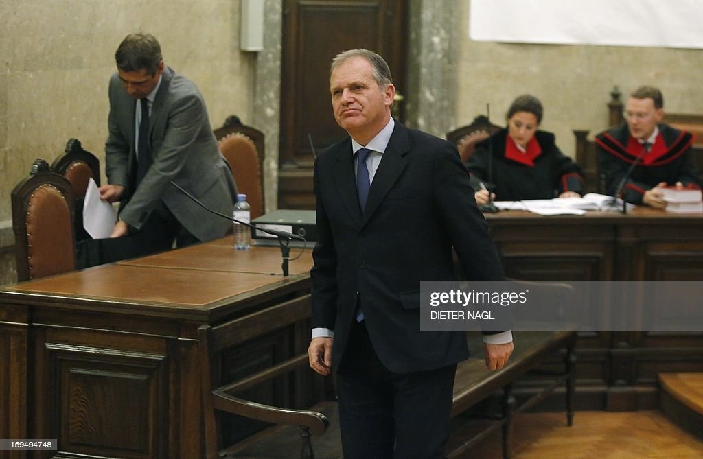 Former Austrian Interior Minister and Austrian former member of the European Parliament Ernst Strasser leaves the court room short before he was convicted to four years in jail on January 14, 2013 in Vienna. An Austrian former member of the European Parliament was sentenced Monday to four years in prison for corruption after being secretly filmed offering to change EU legislation for money. AFP PHOTO/DIETER NAGL