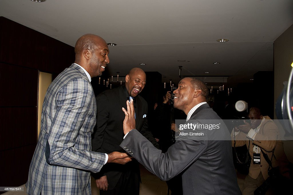 Former 'Bad Boys' Detroit Pistons player John Salley and Isiah Thomas attend a game against the Miami Heat to honor the 1989 NBA Championship team and to celebrate the 25th Anniversary of their first NBA Championship at the Palace of Auburn Hills in Auburn Hills, MI on April 02, 2014.
