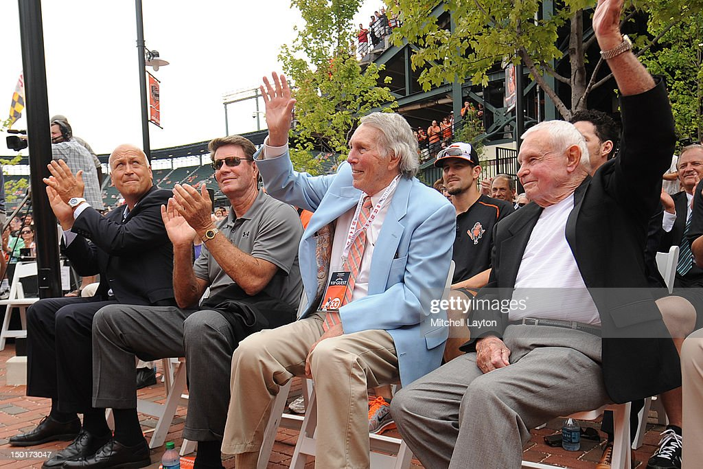 Former Baltimore Orioles (L to R) Cal Ripken Jr.,Jim Palmer, Brooks Robinson and Earl Weaver attend the unveiling of Eddie Murray's bronze sculpture in the Legends Garden before a baseball game against the Kansas City Royals on August 11, 2012 at Oriole Park at Camden Yards in Baltimore, Maryland.