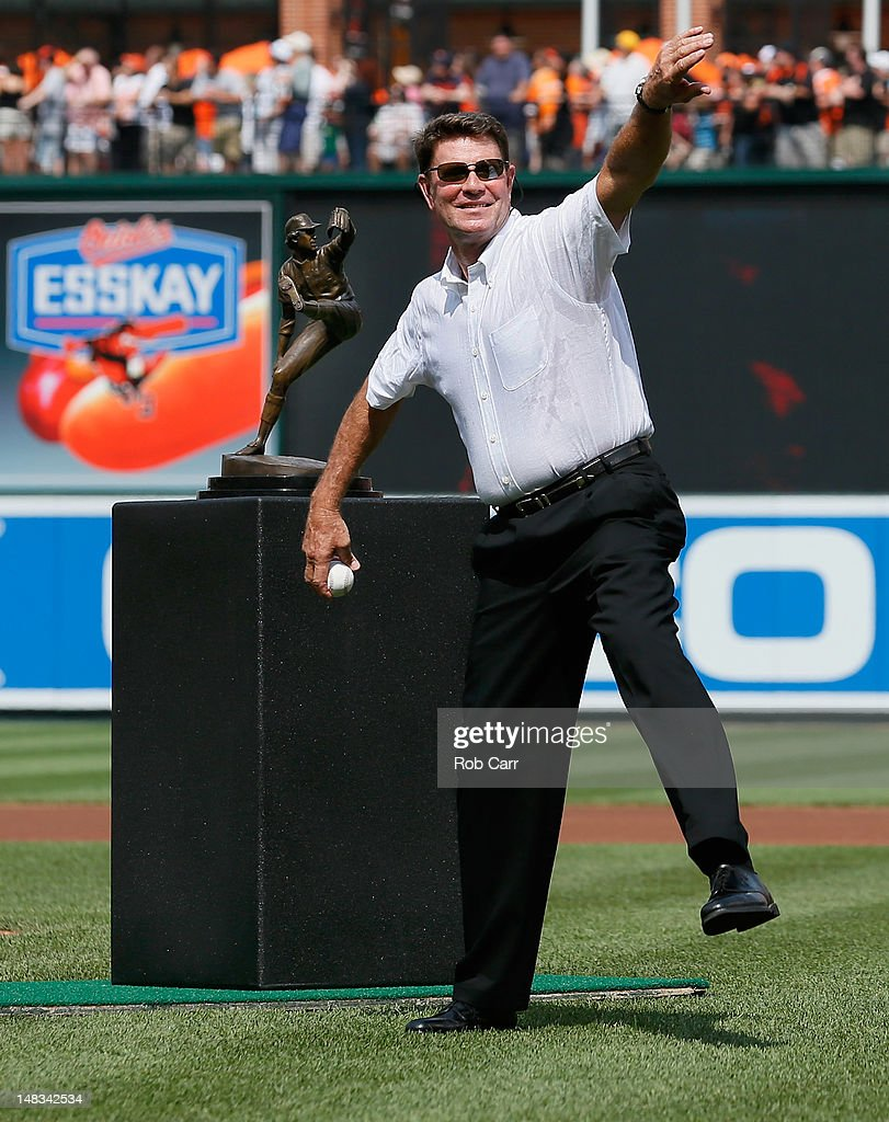 Former Baltimore Orioles hall of fame pitcher <a gi-track='captionPersonalityLinkClicked' href=/galleries/search?phrase=Jim+Palmer&family=editorial&specificpeople=93588 ng-click='$event.stopPropagation()'>Jim Palmer</a> throws out the ceremonial first pitch before the start of the Orioles game against the Detroit Tigers at Oriole Park at Camden Yards on July 14, 2012 in Baltimore, Maryland. The club unveiled a statue of Palmer in the outfield before the game.