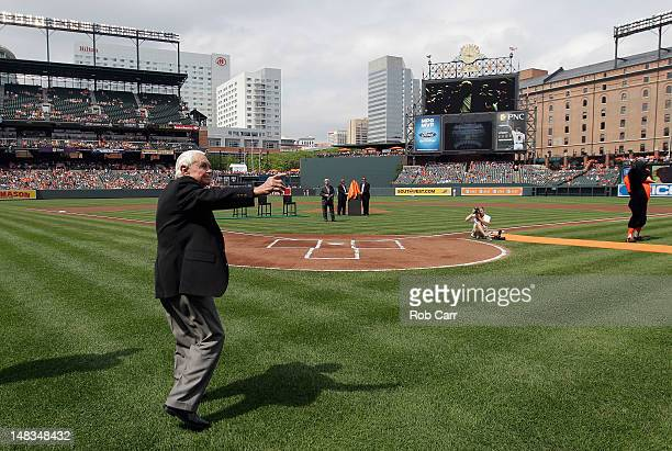 Former Baltimore Orioles manager Earl Weaver waves to the crowd during pre game ceremonies before the start of the Orioles and Detroit Tigers game at...