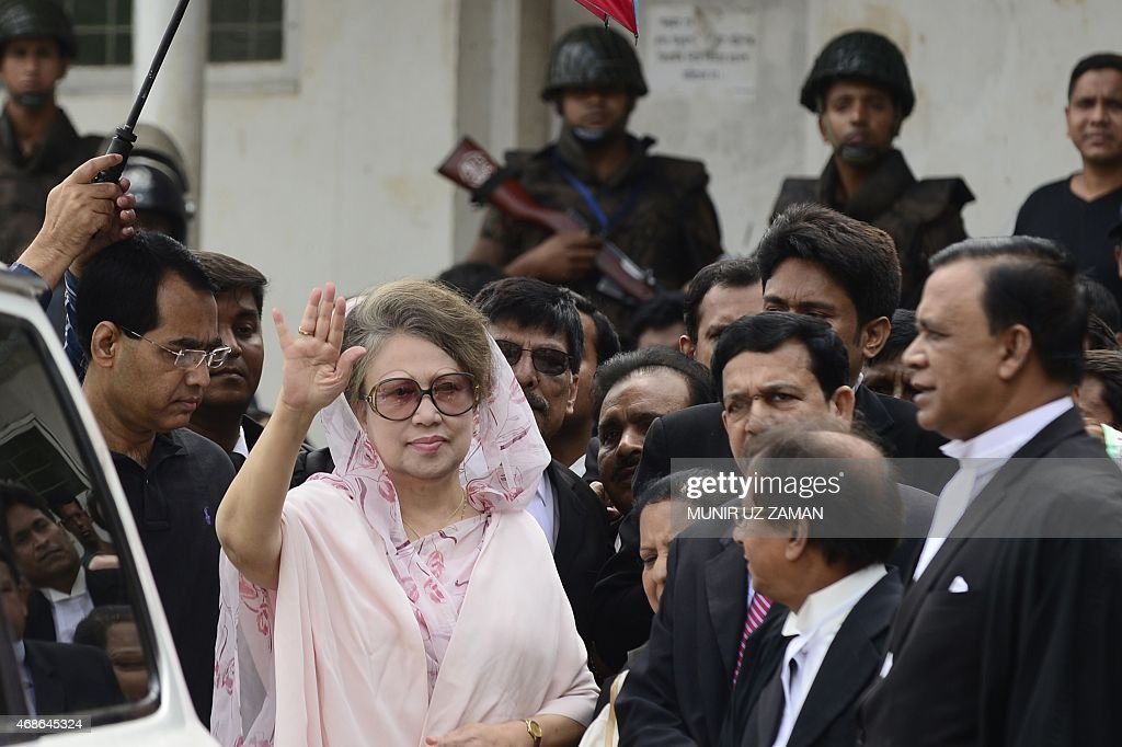 Former Bangladeshi prime minister and Bangladesh Nationalist Party (BNP) leader <a gi-track='captionPersonalityLinkClicked' href=/galleries/search?phrase=Khaleda+Zia&family=editorial&specificpeople=647544 ng-click='$event.stopPropagation()'>Khaleda Zia</a> (C) waves as she arrives for a court appearance in Dhaka on April 5, 2015. Bangladesh opposition leader <a gi-track='captionPersonalityLinkClicked' href=/galleries/search?phrase=Khaleda+Zia&family=editorial&specificpeople=647544 ng-click='$event.stopPropagation()'>Khaleda Zia</a> left her office April 5, 2015 for the first time in three months in a sign of easing tensions after deadly protests had plunged the country into a political crisis. Zia, 69, was taken by car to a court where she surrendered and secured bail in two graft cases against her. Security was tight with hundreds of police and border guards surrounding the court. AFP PHOTO / Munir uz ZAMAN