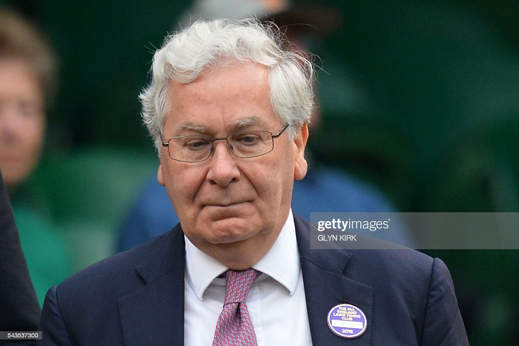 Former Bank of England Governor Mervyn King takes his seat in the royal box to watch Poland's Agnieszka Radwanska play against Ukraine's Kateryna Kozlova during their women's singles first round match on the third day of the 2016 Wimbledon Championships at The All England Lawn Tennis Club in Wimbledon, southwest London, on June 29, 2016. / AFP / GLYN