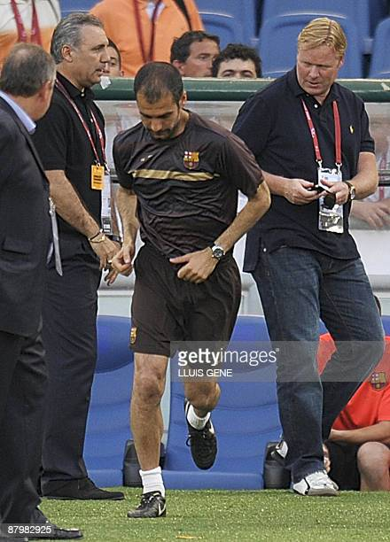 Former Barcelona dream team members Pep Guardiola Hristo Stoichkov and Ronald Koeman watch a training session at the Olympic stadium in Rome on May...