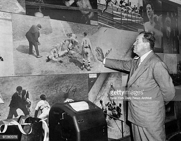 Former baseball and football player Jim Thorpe who also won the pentathlon and decathlon in the 1912 Olympics inspects old sports photos during a...