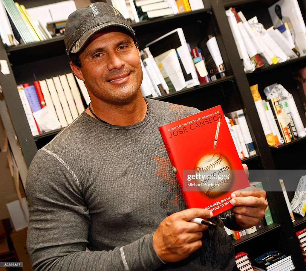 Former baseball player and author <a gi-track='captionPersonalityLinkClicked' href=/galleries/search?phrase=Jose+Canseco&family=editorial&specificpeople=203063 ng-click='$event.stopPropagation()'>Jose Canseco</a> signs copies of his new book 'Vindicated: Big Names, Big Liars, and the Battle to Save Baseball' at Book Soup on April 7, 2008 in Los Angeles, California.