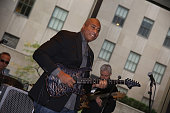 Former baseball player Bernie Williams performs on stage at the Delta Air Lines Presents New York Yankees Pinstripe Brunch Hosted By Josh Capon...