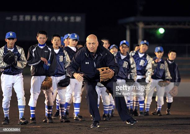 Former baseball player Cal Ripken fields during the baseball lesson held with Sachio Kinugasa at the tsunami devastated area on November 10 2011 in...